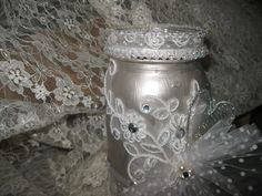 Lace, pearls and bling silver painted mason jar given as a wedding gift or kept for yourself to store makeup brushes or just to sit and look