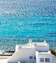 White houses next to the blue sea. Amazing Greece!