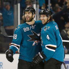 San Jose Sharks defensemen Brent Burns and Brenden Dillon are all smiles after Burns' third period goal (Dec. 9, 2014).