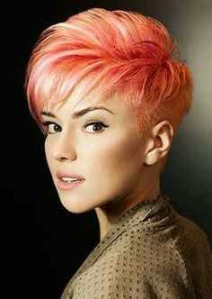 I'd like this girly girl faux hawk someday. I would probably just do super blonde, no red.