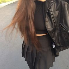 black crop top and leather jacket with black tennis skirt