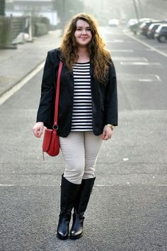 Plus size outfit - black jacket, light jeans, red bag, stripped shirt and black boots.