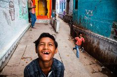 Explosion (Photo and caption by Stylianos Papardelas/National Geographic Traveler Photo Contest) Children playing in the backstreets of old Varanasi. An explosion of colors, smiles and energy. National Geographic Expeditions, National Geographic Images, National Geographic Travel, Travel Images, Travel Photos, Smile Pictures, Photo Caption, Photo Contest, Beautiful Images