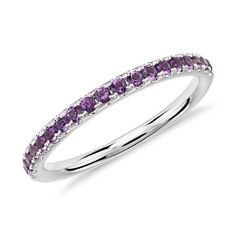 This amethyst half eternity ring is crafted in 14k white gold that captures the vivid purple color.