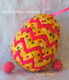 """My new Easter Egg Ornament design is now available in kit with the pattern included to make your own! This ornament is made with a speckledyellow fabric and accented with bright pink. Included in this kit is the complete pattern, smoothfoam 3 1/4"""" egg, precisely cut fabric pieces, ribbon for bows and hangers and decorative pins for the top. You will need to purchase flat head straight pins. Recommend 3/4"""" or 1"""" length."""