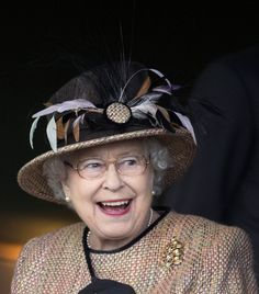 Queen Elizabeth II  I'm sorry, but this looks like her royal majesty has a spider on her hat! :-O