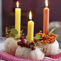 candle centerpieces made with white pumpkins, rowan berries and rose hips