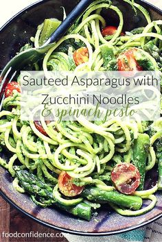Creamy spinach and pistachio pesto is tossed with spiralized zucchini noodles, sauteed asparagus and chopped cherry tomatoes. Perfect weeknight dinner!