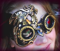 Amazing Dragon Goggles. These are one of the best goggles I have seen. I love the flame design on the left lens. Via thesteampunkempire.com