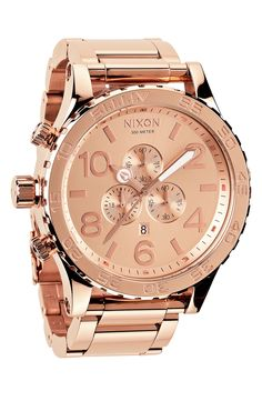A rose gold Nixon watch for him.
