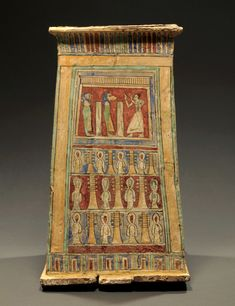 Egyptian wood and polychrome stucco canopic chest