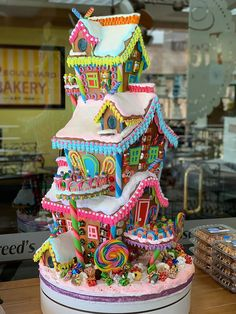 Gingerbread House Inspiration (Top 10 Amazing gingerbread house display made by Sonny Robertson of Freeds bakery in Las Vegas. I love the colors so much! Gingerbread House Pictures, Easy Gingerbread House, Graham Cracker Gingerbread House, Cardboard Gingerbread House, Gingerbread House Template, Gingerbread House Designs, Gingerbread Decorations, Gingerbread Cake, Gingerbread House Decorating Ideas