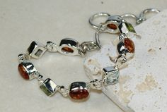 Amber,Mixed Faceted Stonesbracelet designed and created by Sizzling Silver. Please visit  www.sizzlingsilver.com. Product code: BR-8503