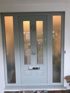 Check out this new Edinburgh Solidor in Painswick Green and Matching frames. Taking Solidor Composite Doors to the next level. What an installation in New Malden Solidor Composite Cottage Front Doors, Grey Front Doors, Front Door Porch, Front Doors With Windows, Front Porch Design, Modern Front Door, Front Door Entrance, Exterior Front Doors, House Front Door