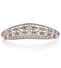 1910, a previously pinned diamond and pearl kokoshnic by Koch.
