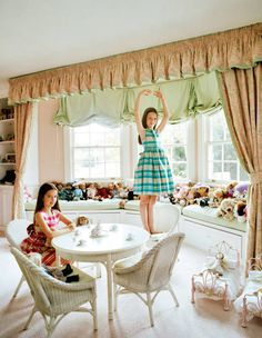 """<p>Olivia (<em>left</em>) and Eleanor Uzielli in their bedroom. Their own Papo d'Anjo dresses.</p> <p><em>Hair and makeup by Amber Kerns for <a href=""""http://www.soloartists.com/MAC"""">Soloartists.com/MAC</a>.</em></p>"""