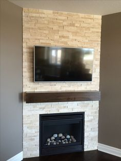 Family room corner fireplace with tv