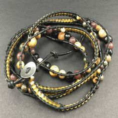 Gold and black wrap bracelet with adjustable clasp try it as a necklace also