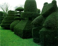 Beckley Park, Oxfordshire: cottage garden topiary formulas taken up in an early 20th century elite English garden in a historic house setting