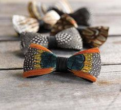 Completely handmade in eastern South Carolina, each of these remarkable bow ties is crafted from carefully selected feathers. While this makes every tie's appearance unique, they all share the same iridescent and original look. Comes in a wood presentation box and makes for a fine gift. USA.
