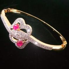 Two Heart American Diamond Ruby Gold Plated Bracelet Bangle *Beautifully hand crafted bracelet bangle *Sparkles like real diamond gold bracelet bangle *High quality American Diamonds are used *Sleek fit bracelet *Free size - fits every hand *Gold plated bracelet bangle   ₹599.00 INR Buy at http://crazyberry.in/online-shopping/artificial-imitation-fashion-jewellery/two-heart-american-diamond-ruby-gold-plated-bracelet-bangle