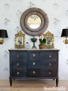 A mirror from Balsamo is flanked by a pair of Italian gilded wood mirrors on a chest of drawers from Cupboards & Roses Swedish Antiques. Design: Brian McCarthy.