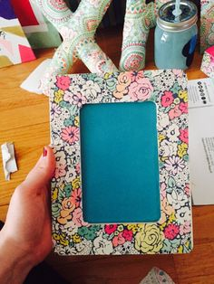 Picture frame made from scrapbook paper, mod podge and wooden frame