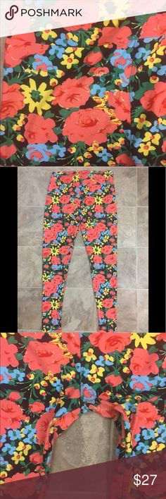 LuLaroe Floral Unique Soft Tall & Curvy Leggings Beautiful floral print LuLaroe leggings! In excellent condition and ready to show off. Nice coral and light blue flowers with green leaves with a black background. Tall and curvy pants that are great for lounging. (I have other LuLaroe leggings in the size Tall and Curvy, Bundle for a nice deal!) LuLaRoe Pants Leggings