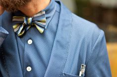 Style Snapshot: Suited for Dots - mini dots on a blue suit and shirt compliment a striped bow tie. #groom #wedding #fashion #mens
