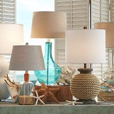 lamps in colored glass or wrapped with rope are perfect accents
