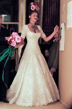 Laetitia Casta - remove all the accessories, and make-up and you have a beautiful wedding gown.