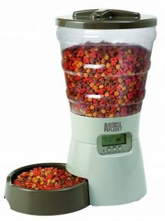 Animal Planet™ Programmable Electronic Pet Feeder features a large hopper that holds up to of dry dog or cat food. Integrated LCD control panel allows you to set custom meal times and portions. Automatic Cat Feeder, Food Portions, Pet Feeder, Cat Feeding, Cat Accessories, Cat Food, Dog Food Recipes, Pet Supplies, Office Supplies