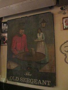 What looks like the original pub sign, inside.