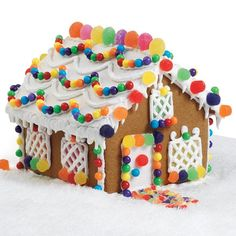 Welcome Inn Gingerbread House - This petite gingerbread house kit is a perfect family project. Little hands will just love adding candies everywhere. Mom and Dad will enjoy decorating lattice on the windows and adding a welcoming cobblestone walk.