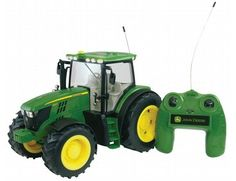 Big Farm Radio Control Tractor John Deere Lights and Sounds Radio-Controlled Tractor features exceptional details, lights and sounds. It can be steered forward, backward, right and left Rc Tractors, John Deere Tractors, John Deere Toys, Custom Muscle Cars, Kid Toy Storage, Farm Toys, Heavy Machinery, Toy Trucks, Remote Control Toys