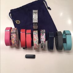 "Fitbit Flex w/Tory Burch Bangle & 9sm wristbands. Fitbit Flex with Silver Tory Burch Bangle and 9 small wristbands and 2 chargers.  Small wristbands are 5.5""-6.6"", Tory Burch bangle is 6.5"". Tory Burch Jewelry Bracelets"