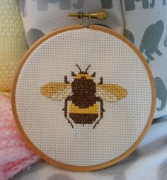 My own design Etsy listing at https://www.etsy.com/listing/238644131/melli-the-bee-cross-stitch-pattern