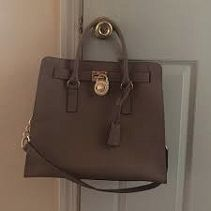 Michael Kors jet set cross body bag Michael Kors jet set cross body bag. This bag does show some signs of wear but they arent very noticeable when using. Still has lots of life left and is a super cute versatile bag! Offers welcome! Michael Kors Bags Crossbody Bags