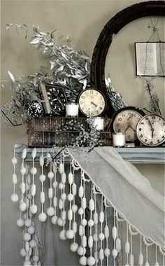 Christmas / Holiday / New Year's Eve Mantel Decor.... Love the fringe and neutral color scheme..