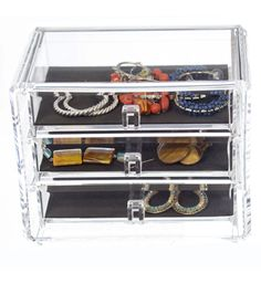Three-Drawer Acrylic Jewelry Chest is a compact chest with clear acrylic for easy viewing. Foam-lined drawers help protect your jewelry.