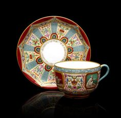 A porcelain cup and saucer from the Raphael Service Imperial Porcelain Factory, St. Petersburg, 1895 and 1902