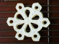 Pearlized lacy snowflake sugar cookie.