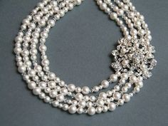 Google Image Result for http://thesharebears.com/Vintage-Clothing/vintage-inspired-bridal-jewelery/vintage-pearl-necklace-with-diamonds.jpg