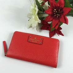 New Kate spade Neda Wellesley red wallet Brand new with tag and care card. kate spade Bags Wallets