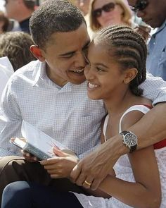 I Simply love this picture of Gratuitous. I saw it on Something Within. It shows Barack Obama with his ten-year-old daughter Malia:  This picture was taken on July 4th 2008 the day Malia turned ten. They are at a Independence Day parade in Butte Montana.  That book that Malia is reading by the way is Outside Beauty by Cynthia Kadohata. What Barack Obama is reading (not pictured) is The Last Campaign: Robert F. Kennedy and 82 Days That Inspired America by Thurston Clarke (so says MSNBC).