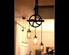 Antigua lámpara del tarro de masón y polea