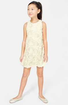 Such a darling ivory embellished soutache dress. It's perfect for a party in the park.