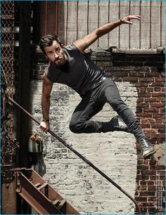 Wearing a Kelly Cole tee and BLK DNM jeans, Justin Theroux leaps into action for Men's Health UK.