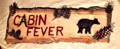 """Custom painted log cabin signs by Valerie Holstein. 24""""x12"""". $90.00. (954)-861-6320"""