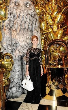 Lana Del Rey in a custom-made lace Mulberry dress from Autumn Winter 2012.